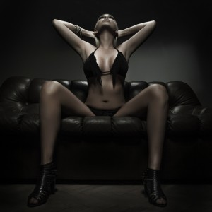 TS cam model on the couch. Performing live sex on cam.